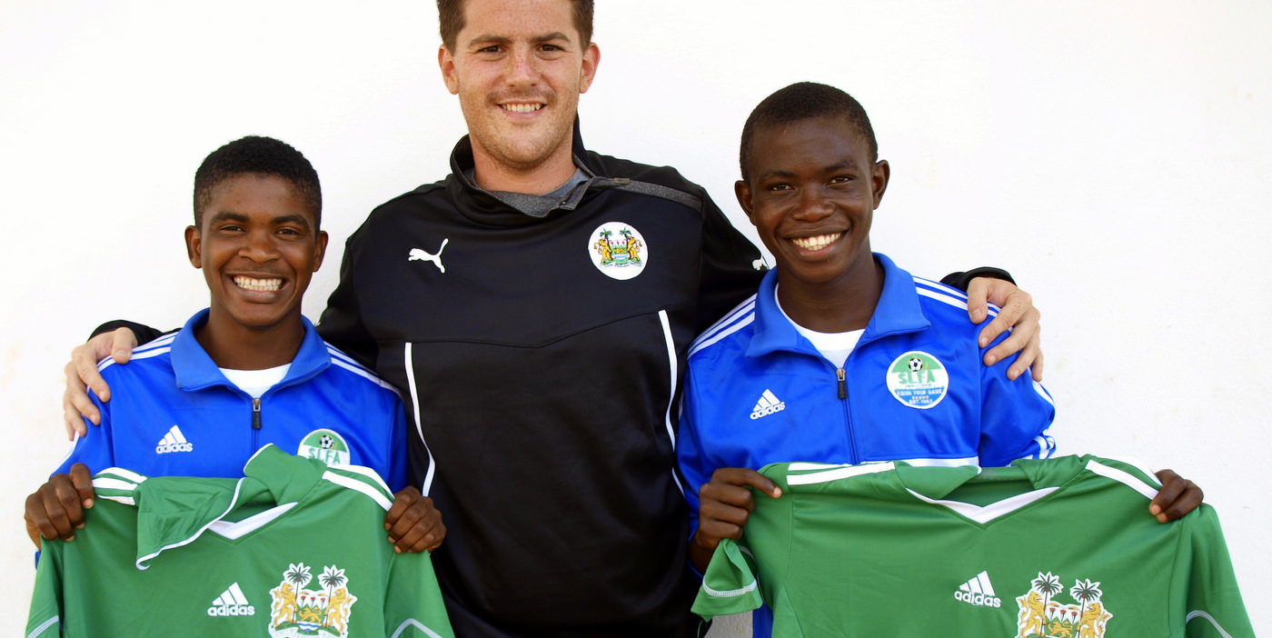 Coach McKinstry with CBF Academy players Santigie Koroma and Sulaiman Samura who were selected for Sierra Leone U-20 [versus Guinea in 2015 CAF U-20 first round qualifying (Picture: Myrthe van Vliet)]