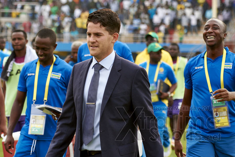 Coach McKinstry and the technical team leave the field following their win [Rwanda vs Gabon, CHAN - Group A, 20 Jan 2016 in Kigali, Rwanda.  Photo © Darren McKinstry 2016, www.XtraTimeSports.net]
