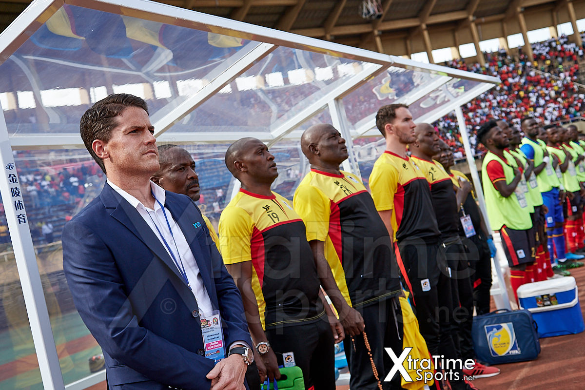 Kampala, Uganda. 17 Nov 2019.  Johnathan McKinstry (Head Coach, Uganda), Abdullah Mubira (Assistant Coach, Uganda), Charles Livingstone (Assistant Coach, Uganda), Fred Kajoba (Goalkeeping Coach, Uganda), Alex McCarthy (Performance Analyst, Uganda) and other technical staff in the dug out ahead of the game.  Uganda v Malawi, CAF Nations Cup / African Cup of Nations Qualifier.  Nelson Mandela Stadium at Namboole.  Credit: XtraTimeSports (Darren McKinstry)