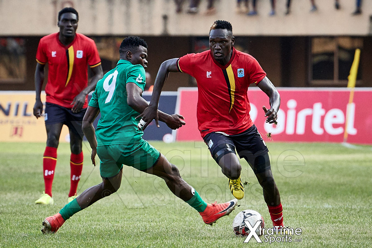 Kampala, Uganda. 17 Nov 2019.  Joseph Ochaya (2, Uganda) moves past Richard Mbulu (9, Malawi).  Uganda v Malawi, CAF Nations Cup / African Cup of Nations Qualifier.  Nelson Mandela Stadium at Namboole.  Credit: XtraTimeSports (Darren McKinstry)