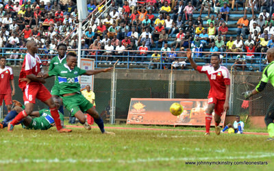 The Seychelles pull down Sheriff Suma, conceding a penalty [Leone Stars v Seychelles, Freetown, 19 July 2014 (Pic: Darren McKinstry)]